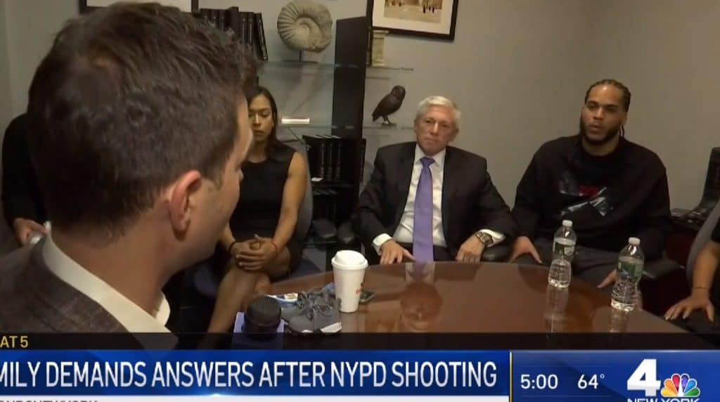 attorney robert vilensky sitting with family of bronx police shooting victim
